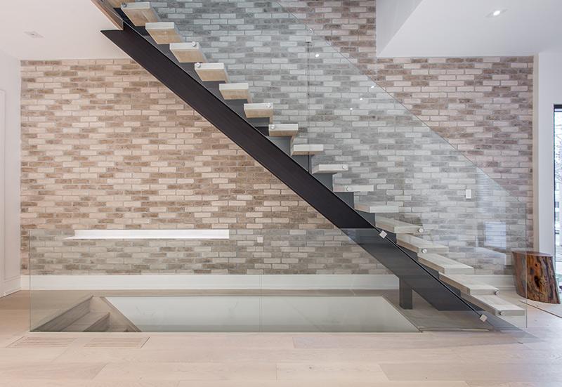 glass-railing-modern-staircase-in-custom-home
